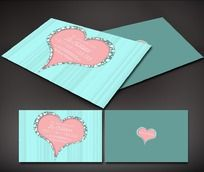 蓝色线条背景上的粉色心形图案名片