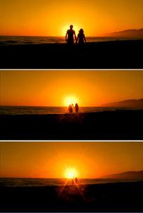 情侣黄昏夕阳漫步海边浪漫爱情视频素材