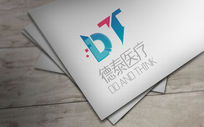 蓝色创意德泰医辽logo