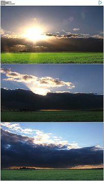 绿色草原上空快速流动的乌云和日落实拍视频素材
