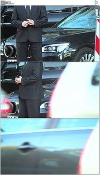 穿西装的司机站在豪车前实拍视频素材