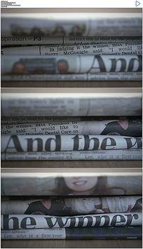 桌面上折叠的报纸实拍视频素材