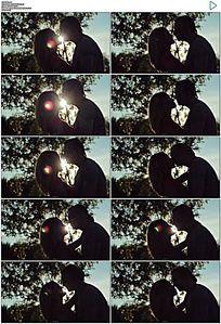 阳光下情侣接吻剪影实拍视频素材