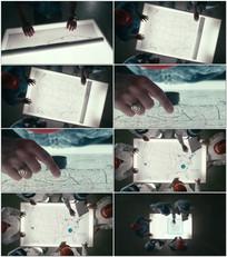 工程师摊开地图研究视频