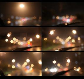 雨后的夜晚坐在车里面拍外面的灯光视频 mp4