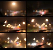 雨后的夜晚坐在车里面拍外面的灯光视频
