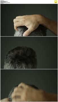 男人头皮痒抓头发实拍视频素材