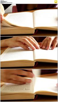 阅读翻书实拍视频素材