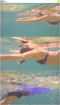 女人在水底游泳实拍视频素材