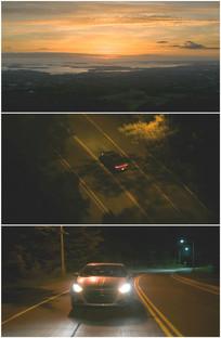 夕阳西下红色晚霞开车回家视频