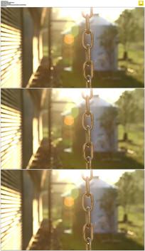 阳光下的铁链水滴实拍视频素材