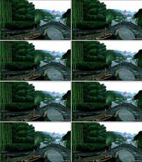 江南雨季拱桥河流小船背景视频