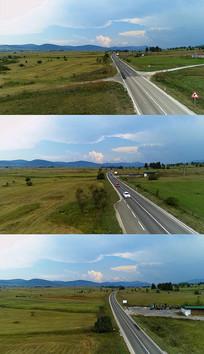 4K平原公路汽车实拍视频素材