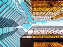 高楼大厦蓝天飞机背景墙