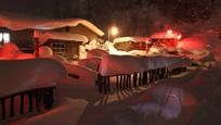 厚厚积雪的农村房屋夜景