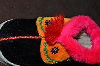 黑橘色宝宝鞋俯拍