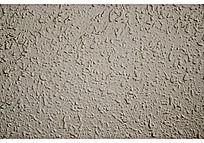 灰白色凹凸纹理墙壁背景图
