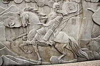 石墙雕刻骑战马的将军形象