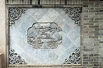 青砖石墙上拼接的中式图案花纹