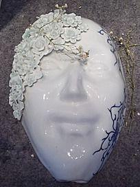 莲花浮雕白瓷人物面相