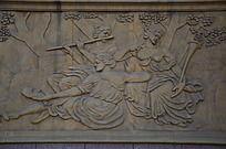 吹笛子的女人浮雕