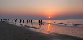 接片拍摄海边日出景色