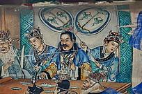 饮酒宴会上的皇帝和举扇子的仕女