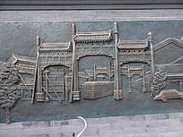 铁艺雕刻牌坊和集市车辆树木大门