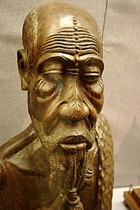 木雕老人头像