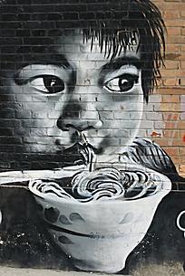 黑白吃面的孩子大眼睛墙上涂鸦绘画