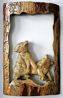 手工木刻画《小黑熊》