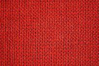 红色化纤麻织物底纹纹理
