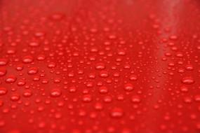 色彩鲜艳的红色雨水水珠背景素材