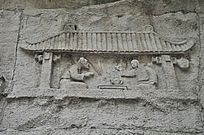 两个古代人物喝茶的石刻壁画