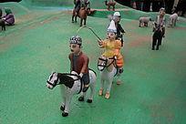 泥塑骑马放牧的人