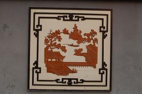 水泥材料白底边框雕刻梅花与木楼