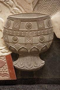 壁刻雕花纹古代酒杯石雕