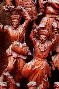 红木雕刻民族团结打腰鼓欢庆