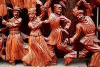 红木雕刻民族团结载歌载舞图案