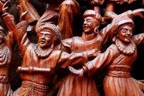 民族团结欢歌跳舞的红木雕刻