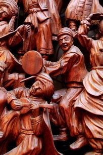 民族团结载歌载舞的红木雕刻