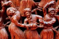 民族团结载歌载舞红木雕刻人像