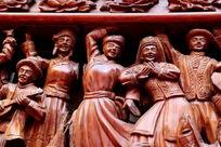 木刻民族团结载歌载舞的雕刻