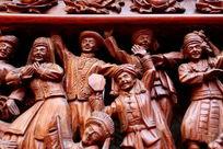木刻民族团结载歌载舞的人像雕刻