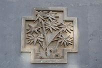 圆形带边框的砖雕竹子和竹叶