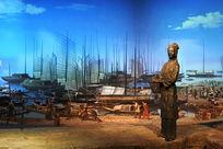 长江边挎篮子的年轻妇女雕像