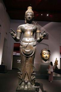 泰国铜雕裙装站佛