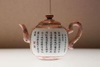 清代粉彩雨中烹茶园景题诗茶壶