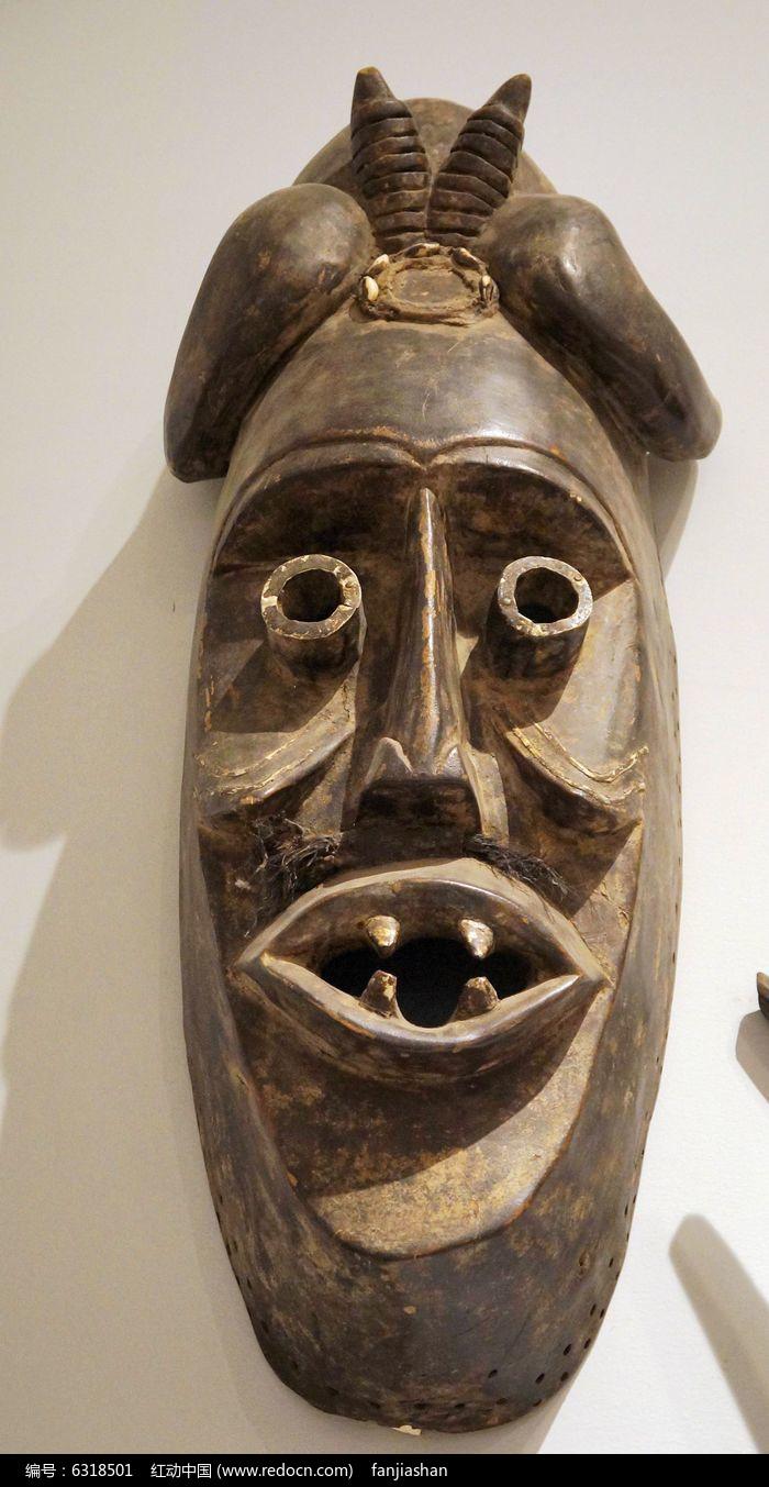 长角咧嘴木雕面具图片