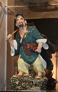 彩色瓷雕道士站姿雕像
